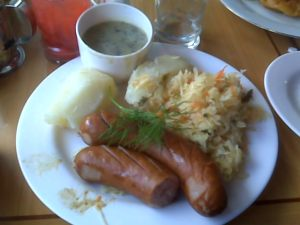Kielbasy, Boiled Potatoes, Sauerkraut and Mushroom Gravy